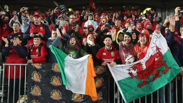 Fans wave the Welsh and Republic of Ireland flags at Eden Park