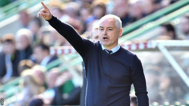 Dundee United manager Ray McKinnon makes a point to his side
