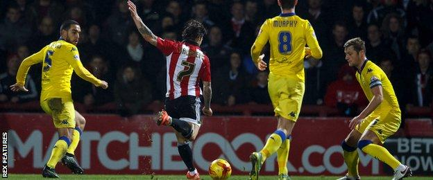 Sam Saunders shoots Brentford in to the lead against Leeds at Griffin Park