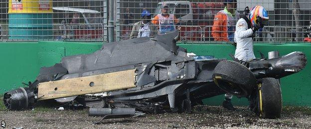 Fernando Alonso walks away from his car