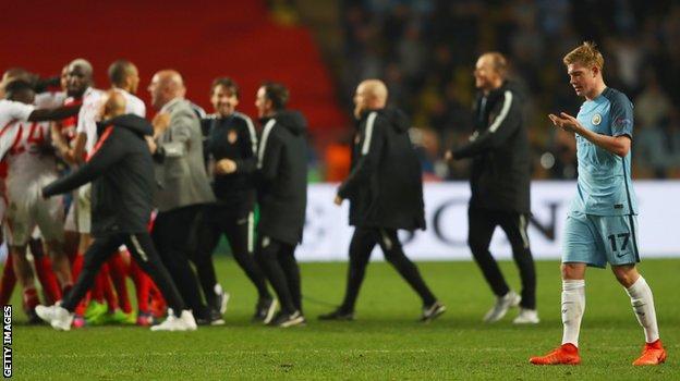 Kevin de Bruyne walks off the pitch as Monaco celebrate