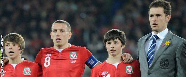 Gary Speed's sons Ed and Tommy with Craig Bellamy and Aaron Ramsey.