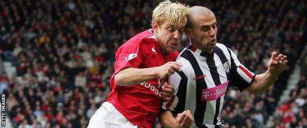 Neil Clement (right) tangles with Alan Smith at Old Trafford in May 2005