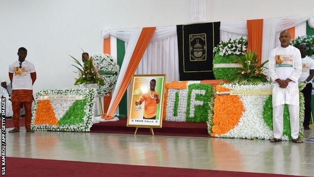 Mourners pay tribute to Cheick Tiote at his funeral in Abidjan
