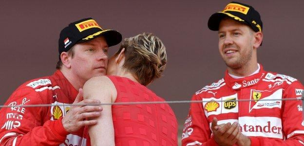 Kimi Raikkonen receives his trophy from Princess Charlene of Monaco