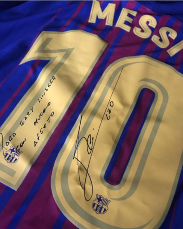 The signed Messi shirt that Fabregas presented to Lineker