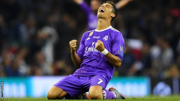 Real Madrid forward Cristiano Ronaldo celebrates as his two goals help Real Madrid beat Juventus 4-1 in the Champions League final