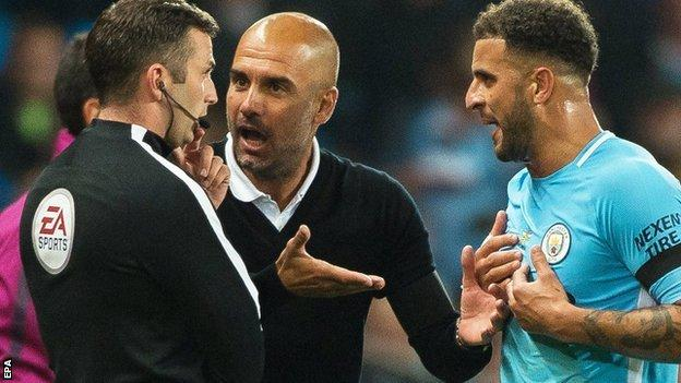Manchester City's Kyle Walker and Pep Guardiola unhappy with red card