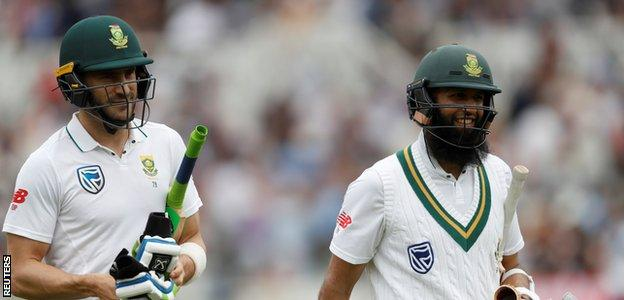 Hashim Amla smiles after another half-century