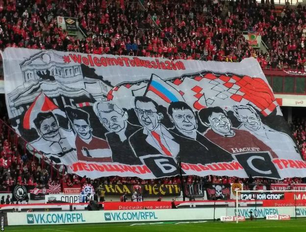 Spartak fans hold banner reading BBC - Blah Blah Channel