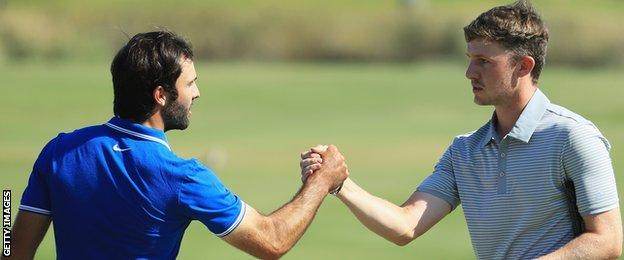 Joel Stalter of France congratulates Connor Syme on the 18th green