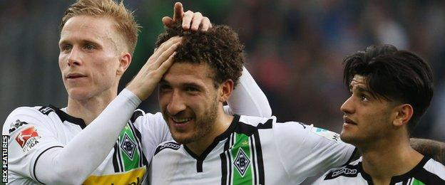 Gladbach celebrate a goal from Fabian Johnson (centre)