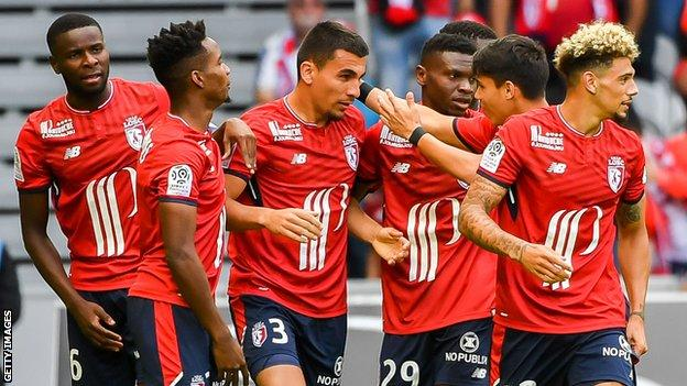 Lille players celebrate scoring against Nantes on August 6 2017