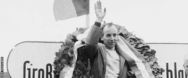 John Surtees celebrates winning a Grand Prix in 1964