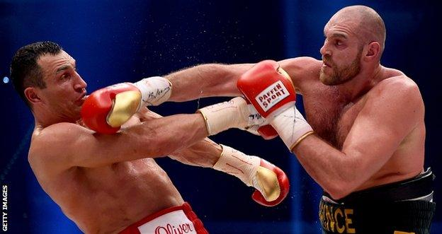 Tyson Fury (right) connects with Klitschko's chin