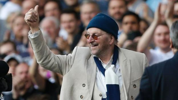Dave of Chas and Dave fame responds after being introduced to the crowd at half-time