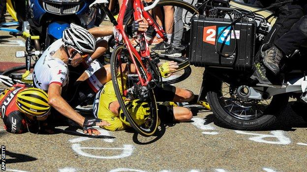 Chris Froome (right), Bauke Mollema (centre) and Richie Porte were left in a heap by the collision with the motorbike