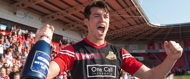 Doncaster's John Marquis celebrates promotion