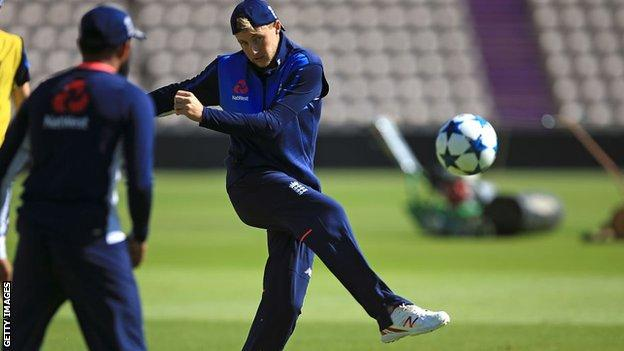 Joe Root shoots during an England training session