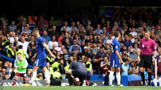 Gary Cahill (left) walks off after his red card