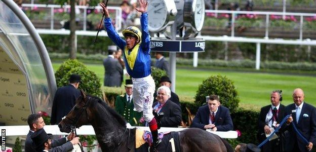 Frankie Dettori performs a flying dismount from Across The Stars