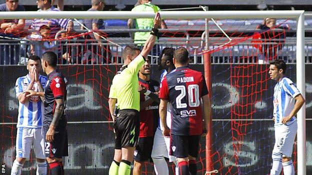 Sulley Muntari is booked
