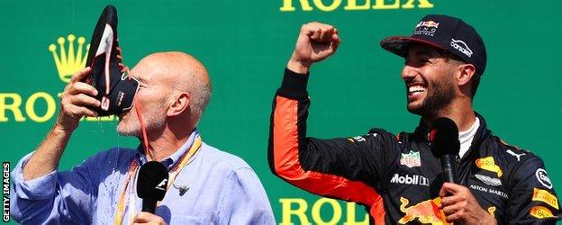 Actor Patrick Stewart does a 'shoey' with Daniel Ricciardo