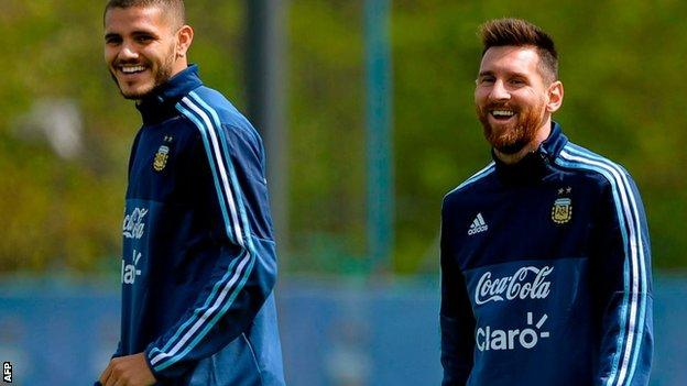 Mauro Icardi and Lionel Messi sharing a joke during a training session on Sunday