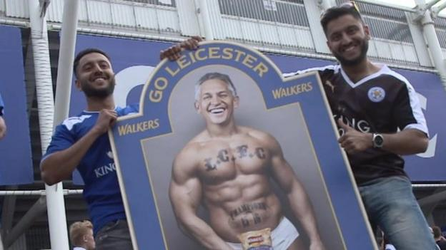 Fans with a mock-up of Gary Lineker