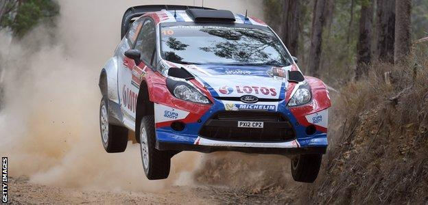 Robert Kubica jumps his Ford Fiesta RS over a brow during the fifth special stage of the World Rally Championship in 2014