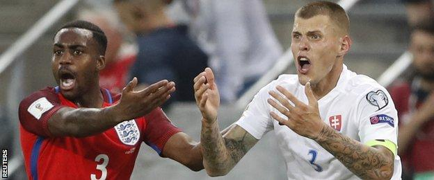 Slovakia's Martin Skrtel (right) is surprised as he is sent off against England