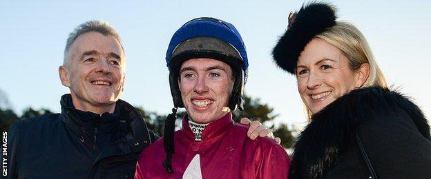 Jack Kennedy (centre) with winning owner Michael O'Leary (right) and the Ryanair boss' wife Anita