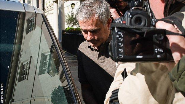 Mourinho was surrounded by media outside his London home
