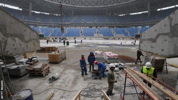 Workers help construct the Krestovksy Stadium