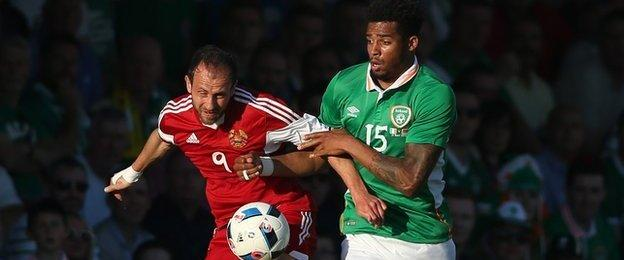 Cyrus Christie challenges Ihar Stasevich during the match at Turner's Cross
