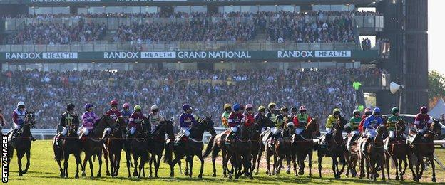 The riders and horses at the start of the Grand National