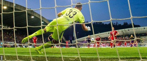 Jasmin Handanovic saves Adam Rooney's penalty