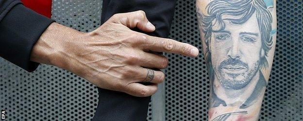 A fan with a Fernando Alonso tattoo