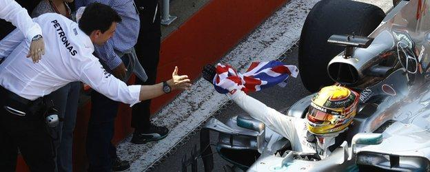 Toto Wolff and Lewis Hamilton celebrate