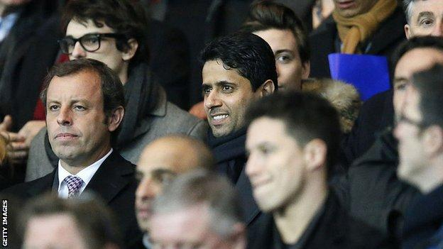 Qatari businessman Nasser Al-Khelaifi (centre) is the chairman of Paris St-Germain