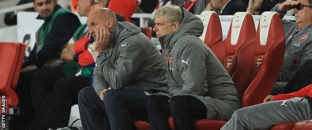 Arsene Wenger (centre right) with coach Steve Bould