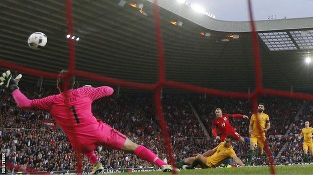 England forward Wayne Rooney scores against Australia