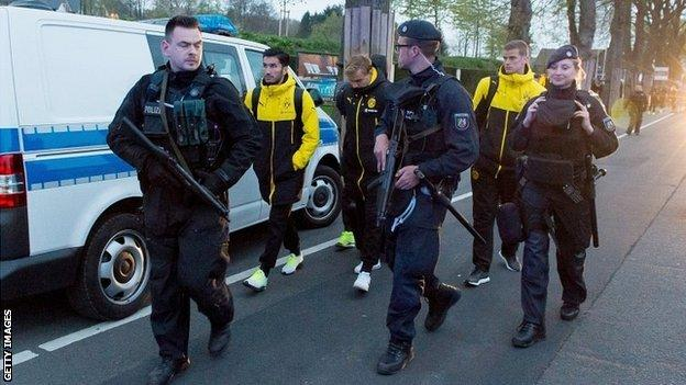 German police escort Dortmund players