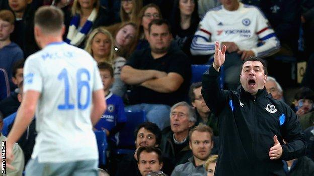 David Unsworth (left) shouts instructions from the dug-out as Everton lose to Chelsea in the Carabao Cup