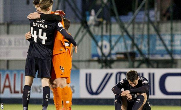 Mark Durnan offers consolation to Falkirk's Paul Watson at full-time