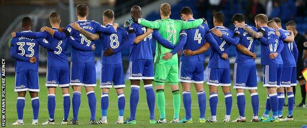 Cardiff City players observe a minute's silence to mark the 50th anniversary of Aberfan disaster