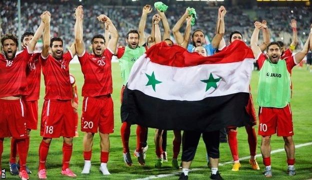 Syrian players celebrate reaching the play-off