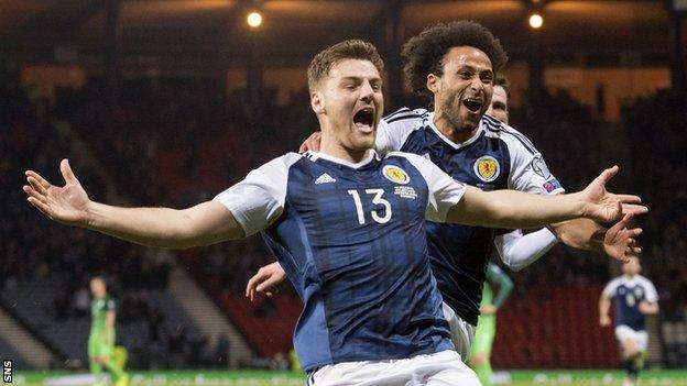 Chris Martin celebrates scoring for Scotland against Slovenia