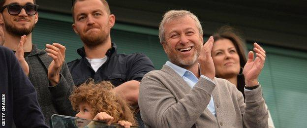 Roman Abramovich (right)