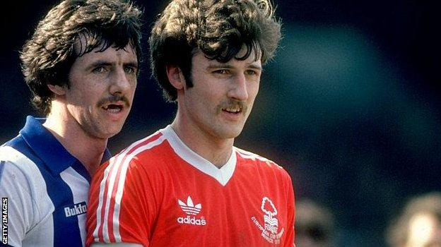 Mark Lawrenson of Brighton and Nottingham Forest's Garry Birtles pictured at the Goldstone Ground in 1980